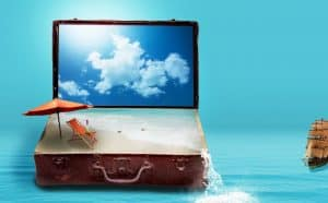 Computer and briefcase filled with sand. Shows a vision board can motivate you to achieve your goals.